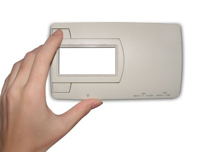 A hand is adjusting a thermostat that is isolated on a white background. Add your own text to the thermostat window. Stock Photo - 5239125