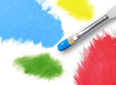 There are different splatters of paint in red, yellow, green and blue on an isolated background. A paint brush is painting with blue paint. photo