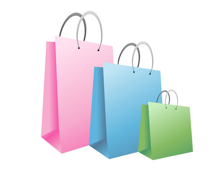 Three colorful shopping bags are on an isolated background. They are pink, blue and green. Use it for the holidays for gifts or a shopping theme.