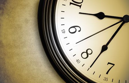 A closeup of a brown clock with a worn texture background. Use it to represent time, a deadline or speed. Stock Photo - 6341381