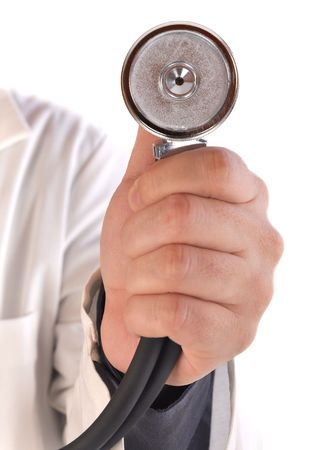A close up of a medical doctor's hand holding a stethoscope on a white isolated background. Image can be used for a health check up or wellness test.
