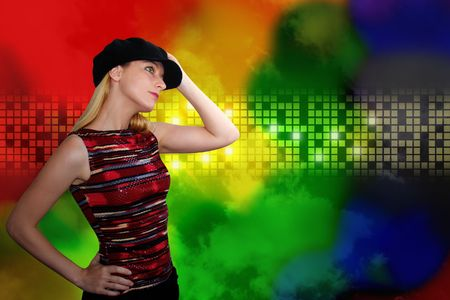 A woman is wearing a black hat and is dancing at an entertainment  nightclub. The background has glowing colored, rainbow squares. Add your text in this area or leave it blank. Stock Photo - 6769139