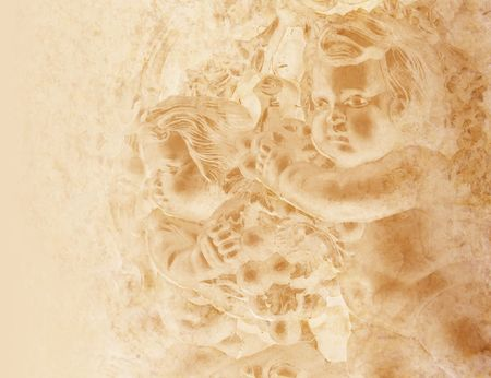 Two cherubs are on a stone wall and they are faded on a light brown gold background. The background is old, worn and textured. photo