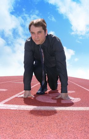 A business man is starting a race / competition on a red track. This photo can represent a variety of ideas from competition to leadership. Stock Photo - 6975388