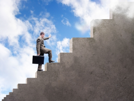 seeking: A business man is climbing up stairs that get larger and larger. A cloudy sky is in the background.