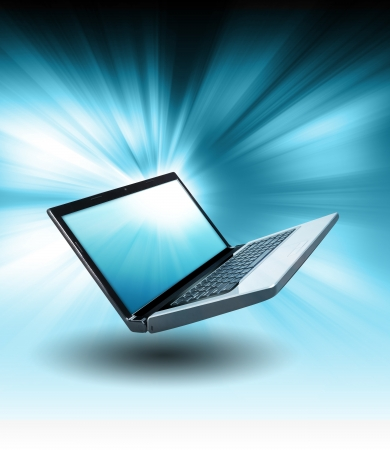 A laptop is floating in the air with a blue zoom glow in the background  Use it for a technology or internet concept   photo