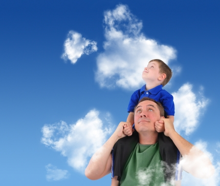 A father and son are looking up at the sky with clouds  The child is sitting on his dad s shoulders and looks happy