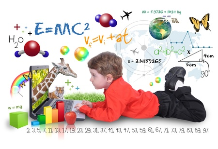 A young boy child is looking at a laptop computer with math, science and animals around him  He is on a white background  Use it for a school, study or learning concept