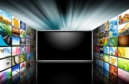 A flat screen television has a blank black text area with photo images coming out of the sides of it  The tv has a glowing light coming out the top  Use it for a media technology concept  Stock Photo - 16963536