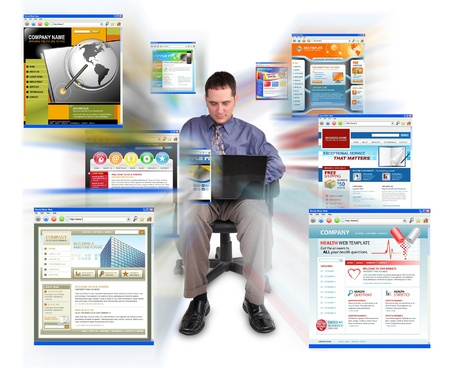 A business man is sitting on a white, isolated background and is working on a laptop computer  He is browsing technology websites that are zooming out  Can represent speed or commerce  photo