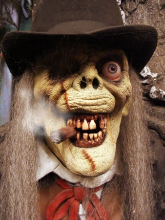 A scary Halloween character is wearing a hat and smoking a cigar   Stock Photo - 17352551