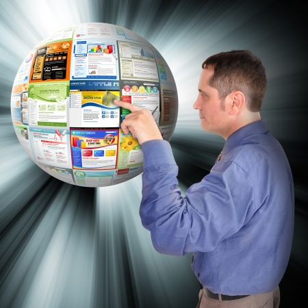 surfing the web: A business man is pointing to an abstract internet ball with websites on it  There are glowing rays coming out of it  Use it for a technology concept