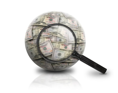 A magnifying glass is looking at a ball of American money on a white isolated background  photo