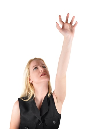 A woman is reaching up to the sky aiming at something, There is an isolated white background  Use it for a goal or achievement concept Stock Photo - 17348373