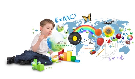 science lesson: A young boy is sitting on a white isolated background blowing bubbles of science, nature, math and art  Use it for an education or creative concept  Stock Photo