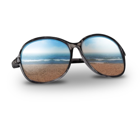 shades: Black sun glasses have a beach with sand reflecting on an isolated white background
