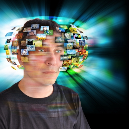 A technology man has images around his head with an abstract glow  Use it for a communication or tv concept Stock Photo - 17388499
