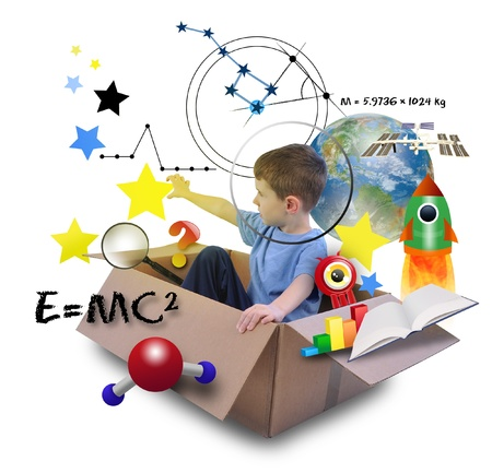 A young boy is using his imagination in a space box photo
