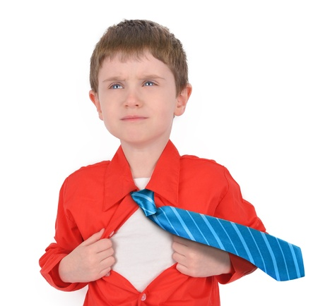 A young boy is holding his shirt open with his tie flying for a hero rescue concept