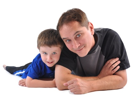 men s: A father and son are smiling and bonding on a white isolated background for a family or parenting concept