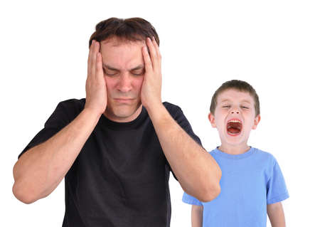 A young boy is screaming at his father in the foregroundd  photo