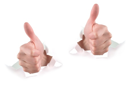 follow through: Two hands are ripping through white paper and giving thumbs up for approval. Use it for a fan, achievement or communication concept.