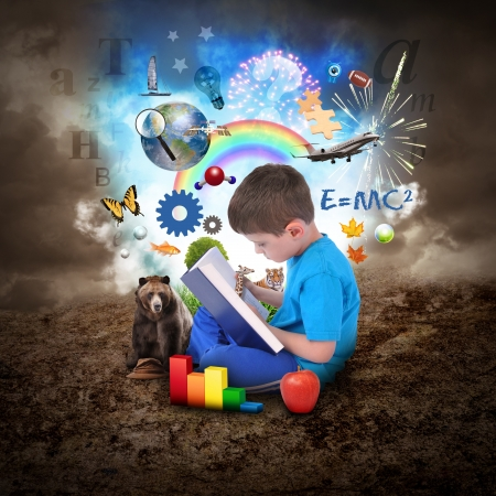 A young boy is reading a book with school icons such as math formulas, animals and nature objects around him for an education concept. photo