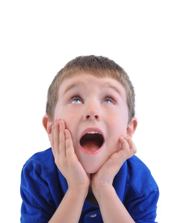 A little boy is looking up with his mouth open and hands on his face with excitement Stock Photo - 20145939
