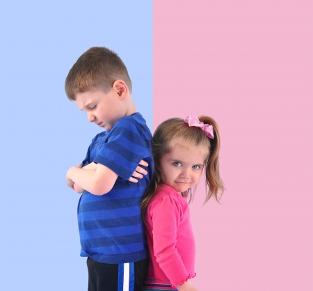 sister: Two children are standing on a pink and blue divided background upset and unhappy for a discipline or gender concept.