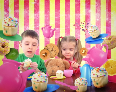 Children are playing at a table with snack food cookies and teapots for a friendship and imagaination concept