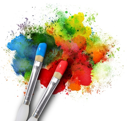 vibrant paintbrush: Two paintbrushes are painting a rainbow splattered art project. The brushstrokes are messy on a white isolated background. Stock Photo