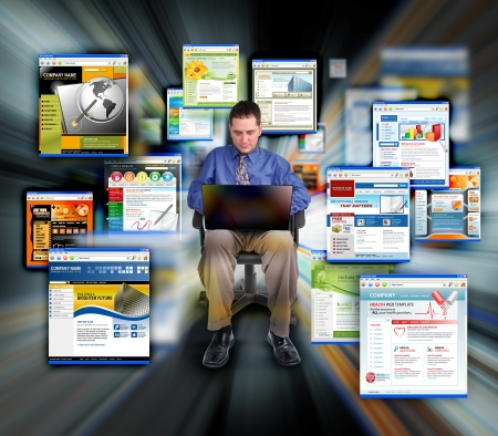 A business man is sitting on a black background and is working on a laptop computer. He is browsing websites that are zooming for speed.  photo