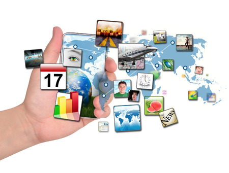 A person is holding a smart phone isolated with a map of the Earth and various apps coming out of the phone. Use it for a communication concept.  Banque d'images