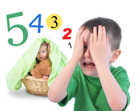 Two children are playing Hide and Go Seek on a white isolated background  There are math numbers for a countdown  The kids are happy