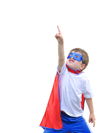 A young boy is dressed up as a hero and pointing up with a mask and cape  There is a white isolated background  Use it for a strength or halloween concept