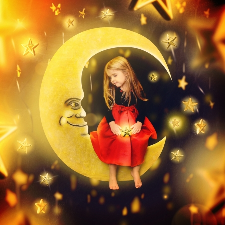 A little girl is sitting on a drawing of a bright moon with falling stars in the background. The child is makign a wish for a imagination or bedtime concept. Stock Photo