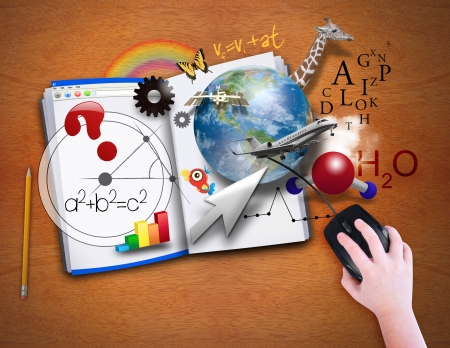 matematica: Un ni�o est� mirando un libro abierto como una computadora Foto de archivo