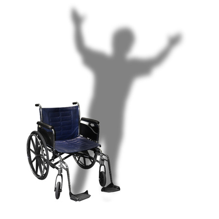 An isolated wheelchair is on a white with the shadow of a person walking for a handicap or rehabilitation concept. Stock Photo