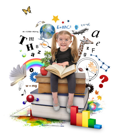 A young girl with glasses is reading a book with school icons such as math formulas, animals and nature objects around her for an education concept on white. Stock Photo