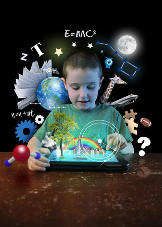 educational: A young boy child is looking at a computer tablet with math Stock Photo