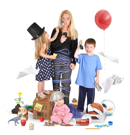 A working mother is stressed and tried on a cell phone with wild children making a mess for a discipline or parenting concept   photo