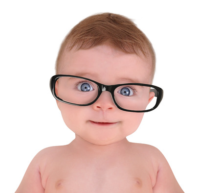 A cute little baby is wearing eye glasses on a white isolated background for education or vision concept  Foto de archivo