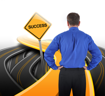 seeking solution: A business man is standing in front of a golden road with a yellow success sign to represent his path decision.