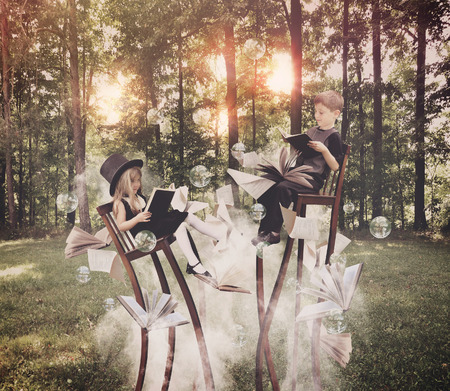 reading: Two children are reading books on long, surreal chairs in the woods with smoke underneath with bubbles in the air for an education or imagination concept.