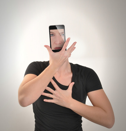 A young girl has an smartphone for a face on a white background for an electronic cell phone addiction concept about social culture.