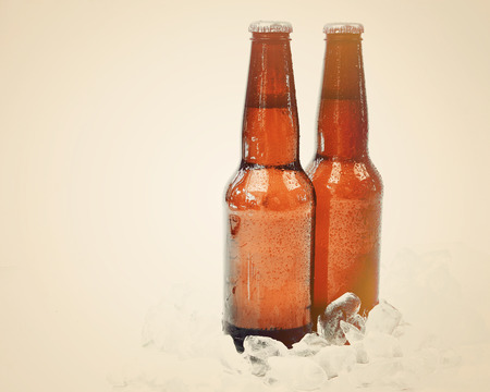 Two ice cold glass bottle photo