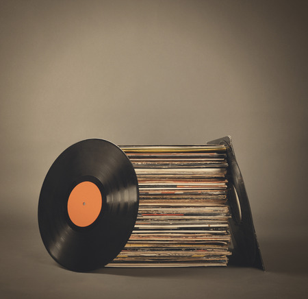retro radio: A stack of old retro vinyl records on an isolated gray background for a party or entertainment concept. Stock Photo
