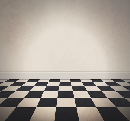A black and white retro checkered old floor and a blank white textured wall. Add your own text message to the empty area. Фото со стока - 37468684