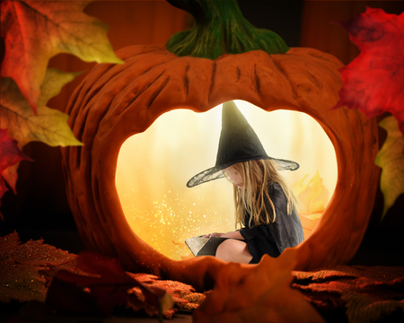 A little halloween witch is sitting inside a glowing pumpkin reading a story book with magical sparkles for a mystery or imagination concept.