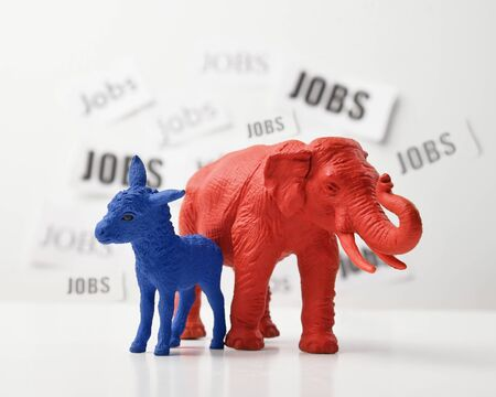 A blue donkey and a red elephant are againts a white wall that has job text in the background for a 2020 political issue of employment rate and the economy.
